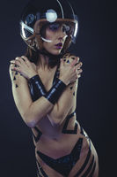 Safe, woman with motorcycle helmet, naked girl dressed with black ribbons by the body. concept speed and security