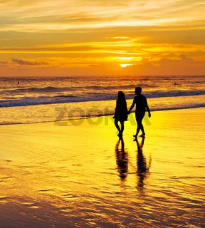 Couple walk tropical beach. Bali