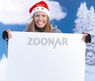 Woman in santa hat holding huge letter smiling