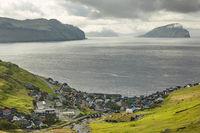 Village in wild and beautiful coastal landscape of Faroe Islands, Denmark