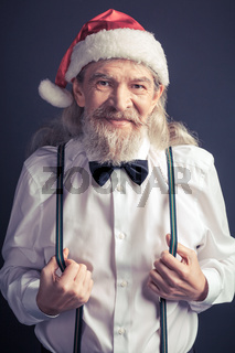 Happy Santa Claus in white shirt and black bow tie.