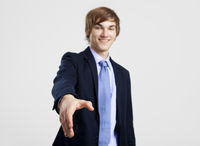 Businessman giving a handshake
