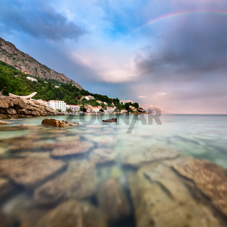 Rainbow over Rocky Beach and Small Village after the Rain, Dalmatia, Croatia