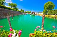 Peschiera del Garda turquoise river Mincio mouth in lake view