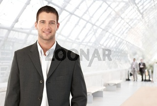 Young businessman in office lobby