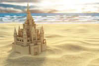 Sand castle on the beach on the sea and sky background.