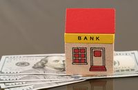 Toy bank building on US dollar assets
