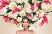 Abstract fashion portrait of young beautiful asian woman face with flowers hairdo