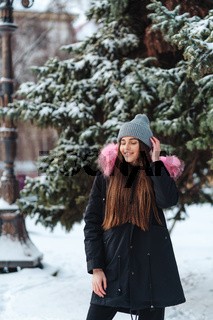 Young beautiful woman at winter city