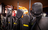 HDR - Firefighter equipment in a fire truck with walkie talkies