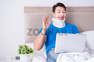 Young man with neck injury in the bed