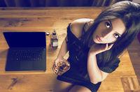 Brunette woman sitting on wooden office