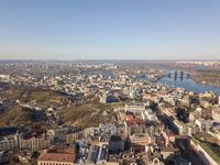 Panoramic view of Kiev, Podol district, Vozdvizhenka and Bald mountain aerial view.