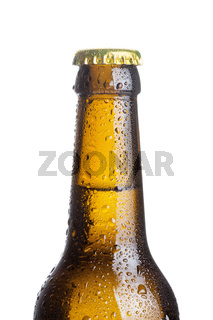 closeup of brown beer bottle with drops isolated on white background