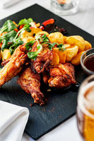 Roasted chicken wings with fried potato