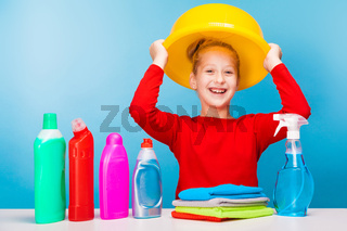 adorable girl holding a yellow basin near her head