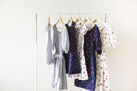 Cloth Hangers with dresses. Women's  clothes.