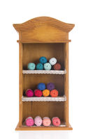 Vintage wooden cabinet with knitting wool