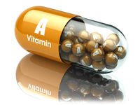 Vitamin A capsule or pill. Dietary supplements.