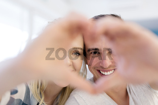 couple making heart with hands