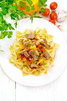 Farfalle with turkey and vegetables on board top