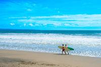 Two man surfing beach