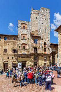 Tourists at the Piazza della Cisterna in San Gimignano, Italy