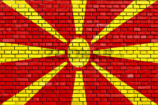 flag of Macedonia painted on brick wall