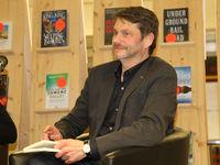 Buchautor Andreas Speit bei einer Buchlesung in der Stadtbibliothek Magdeburg am 13.02.2018