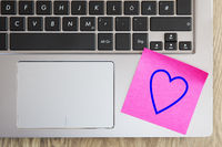Laptop keyboard with heart note