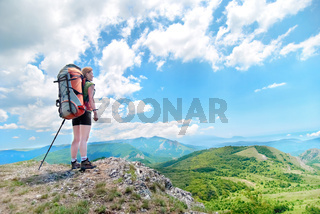 Young happy woman with backpack