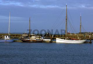 Sailing, fishing ships at bay
