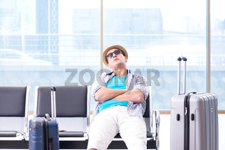 Young man travelling for his summer beach vacation