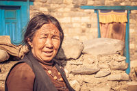 Old frowning woman in Nepal