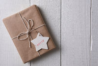 Christmas present wrapped with plain brown paper