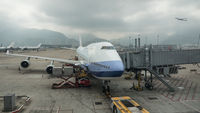 Loading cargo into the plane, Hong Kong