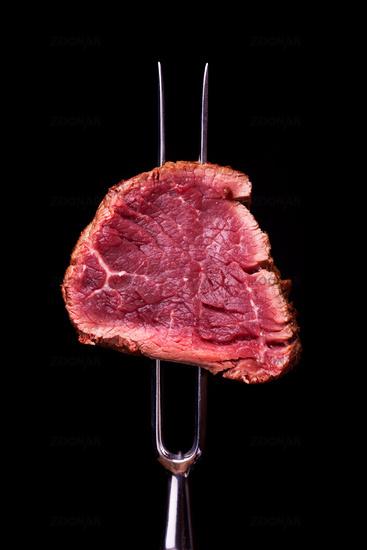 Stück Steak auf eine Fleischgabel