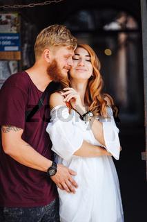 beautiful couple posing outdoors