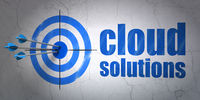 Cloud computing concept: target and Cloud Solutions on wall background