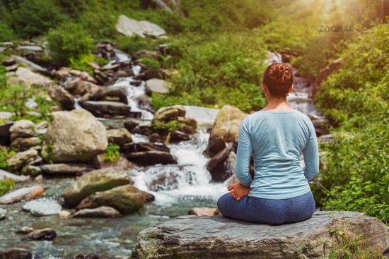 Yoga outdoors - Padmasana asana lotus pose