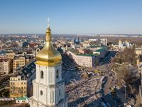 view landscape in Kiev with St. Sophia bell tower and people sightseeing at Sofiiska square