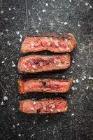 Sliced medium rare grilled steak