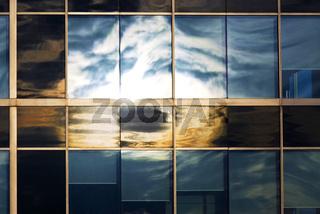 Sky reflecting in office windows