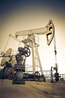 Oil pump jack and wellhead in the oilfield