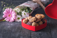 Red box with cookies and flowers