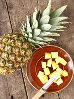 Sweet organic pineapple on wood