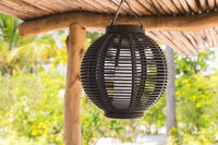 lantern hanging under shed roof