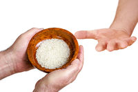 Hand holding wooden bowl with rice