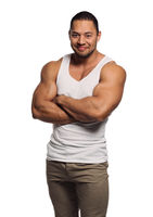 Muscular build young man isolated on white background