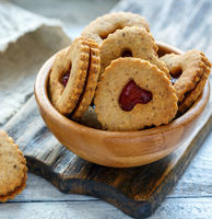 Homemade Linzer cookies with strawberry jam.